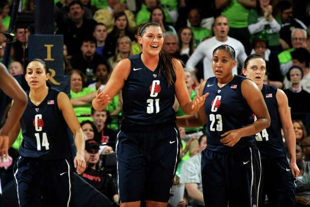 Connecticut forward Stefanie Dolson, middle, reacts to a foul call as teammates Bria Hartley left, and -Kaleena Mosqueda-Lewis, middle right, and Kelly Faris, far right, look on during action in a college basketball game Monday March 4, 2013 in South Bend, Ind. (AP Photo/Joe Raymond) Photo: Joe Raymond, Associated Press / FR25092 AP