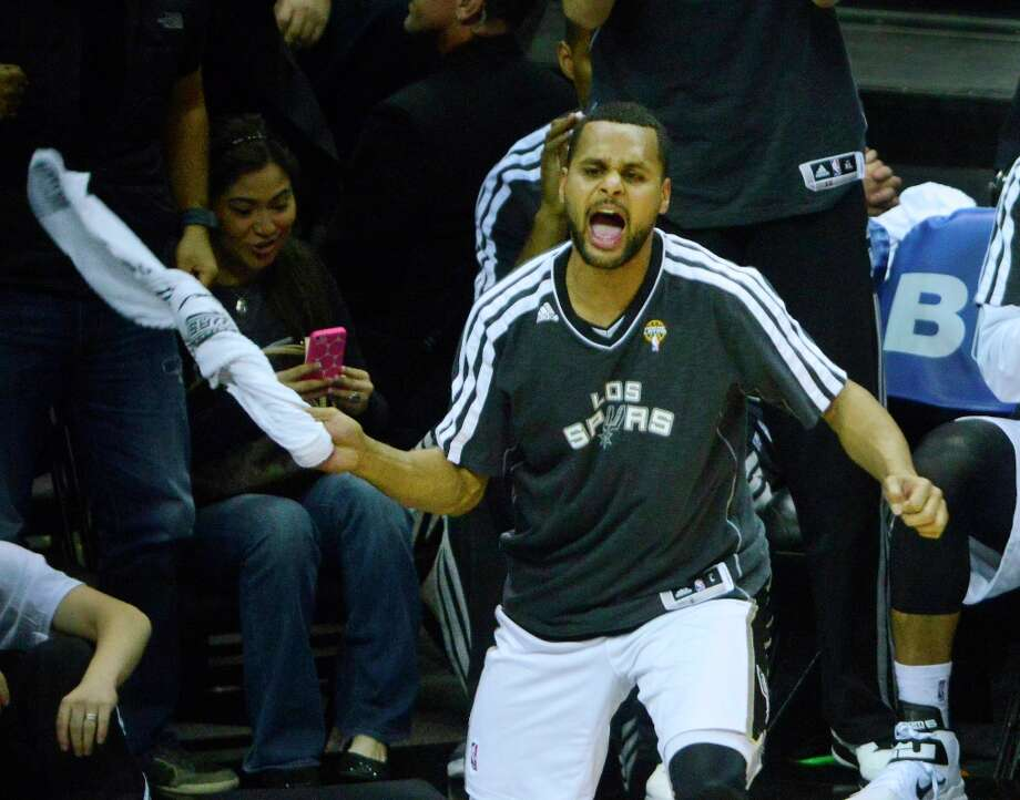 An affable Australian and backup point guard by trade, 24-year-old Patty Mills did not re-sign with the Spurs last July with designs on becoming a glorified cheerleader. It just sort of worked out that way. Photo: Billy Calzada, San Antonio Express-News / San Antonio Express-News