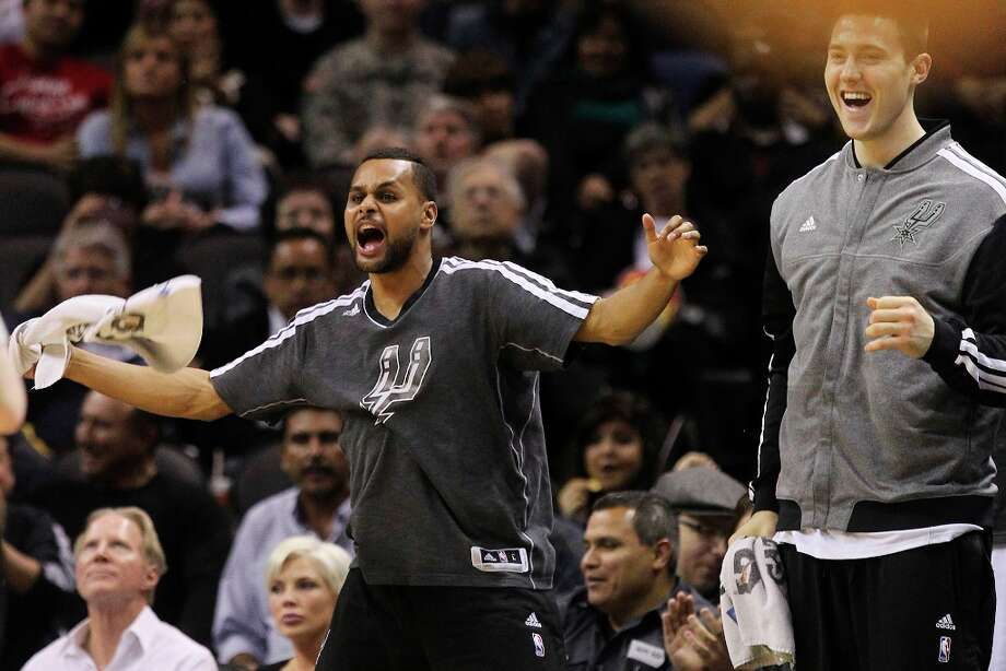 The Spurs' Patty Mills twirls a towel after a score against the Sacramento Kings at the AT&T Center on March 1, 2013. Photo: Kin Man Hui, San Antonio Express-News / © 2012 San Antonio Express-News