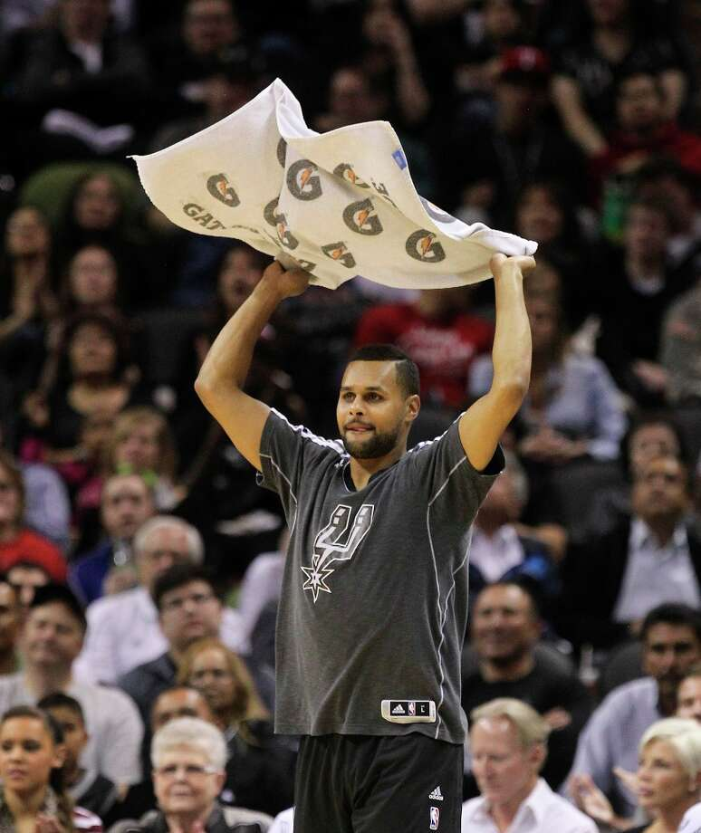 The Spurs' Patty Mills waves a towel after a score against the Sacramento Kings at the AT&T Center on Friday, Mar. 1, 2013. Spurs defeated the Kings, 130-102. Photo: Kin Man Hui, San Antonio Express-News / © 2012 San Antonio Express-News