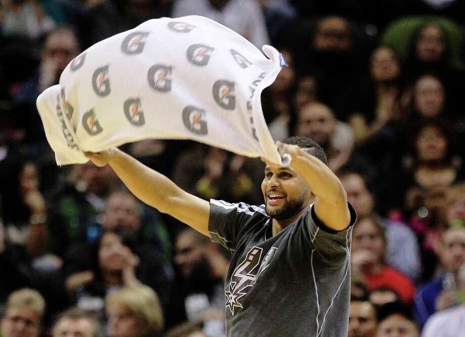 The Spurs' Patty Mills waves a towel after a score against the Sacramento Kings at the AT&T Center on Friday, Mar. 1, 2013. Photo: Kin Man Hui, San Antonio Express-News / © 2012 San Antonio Express-News