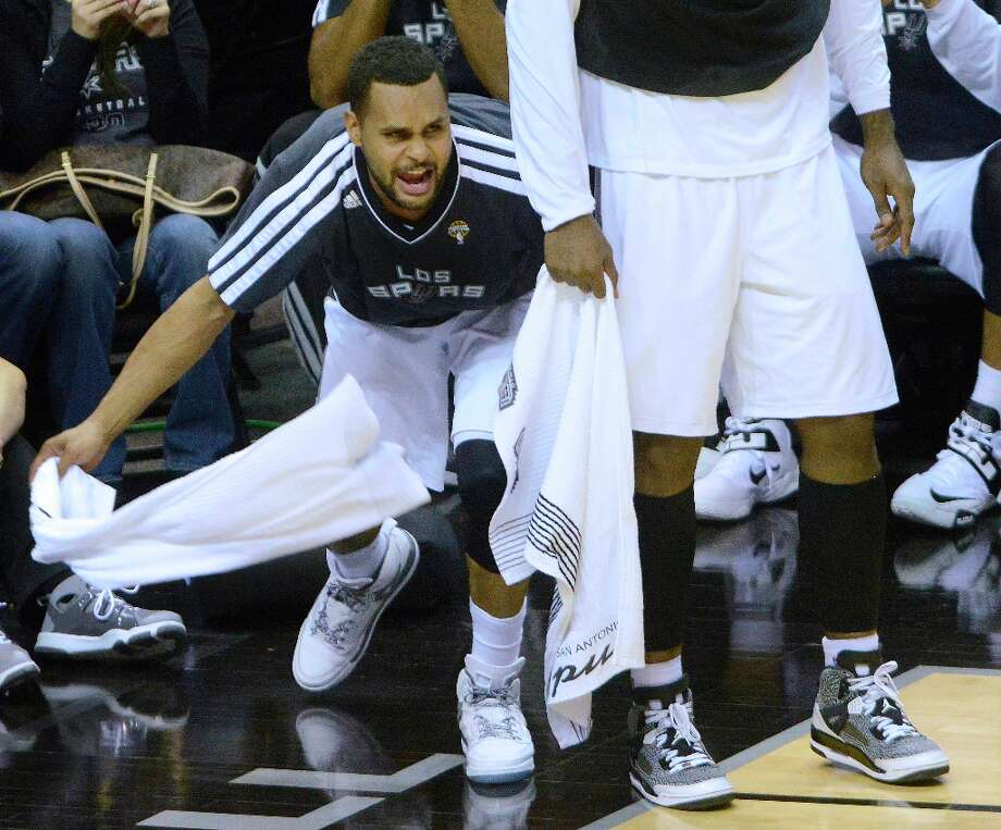 Patty Mills finds time to wave his towel in support of his Spurs teammates despite playing 22 minutes and scoring 13 points against the Chicago Bulls in the Spurs' 101-83 victory at the AT&T Center on March 6, 2013. Photo: Billy Calzada, San Antonio Express-News / San Antonio Express-News