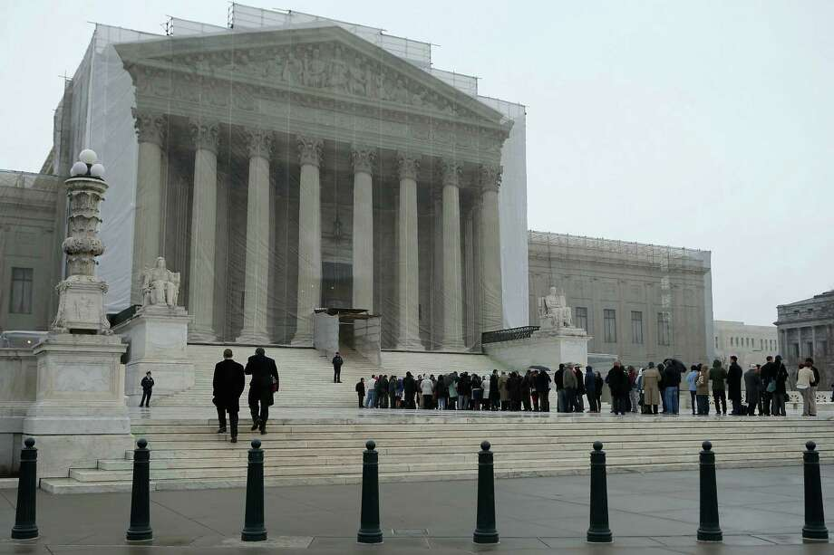 People stand in line outside the U.S. Supreme Court on Monday for a chance to hear oral arguments in a case involving Arizona's mandating more proofs of citizenship than are required by federal law for voter registration. Photo: Chip Somodevilla / Getty Images