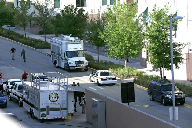 Various police agencies are seen during an investigation at the University of Central Florida, Monday, March 18, 2013, in Orlando, Fla., after explosive devices were found by authorities investigating the apparent suicide of a college student in the dorm. Hundreds of students were evacuated, though the school said there was no immediate threat.   (AP Photo/John Raoux) Photo: John Raoux