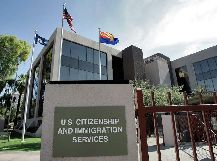 FILE – This Aug. 5, 2008, file photo shows the U.S. Citizenship and Immigration Services building Phoenix. The Supreme Court argued Monday, March 18, 2013 over whether states fighting voter fraud and illegal immigration can make people document their U.S. citizenship before allowing them to use a federal voter registration system that was designed to make it easier to vote.  (AP Photo/Matt York, File) Photo: Matt York