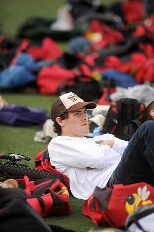 Recovering from a concussion, Emmit Fenn watches from the sidelines as his Berkeley High School lacrosse teammates practice on Monday, March 18, 2013, in Berkeley, Calif. Fenn, the team captain, suffered a minor concussion during a match Friday and has instructions to sit out at least a week. Photo: Noah Berger, Special To The Chronicle