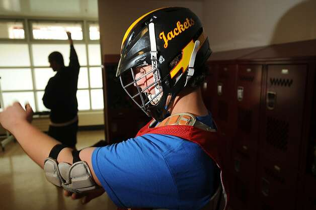 Quinn Gaebler suits up in protective gear before lacrosse practice at Berkeley High School on Monday, March 18, 2013, in Berkeley, Calif. Photo: Noah Berger, Special To The Chronicle