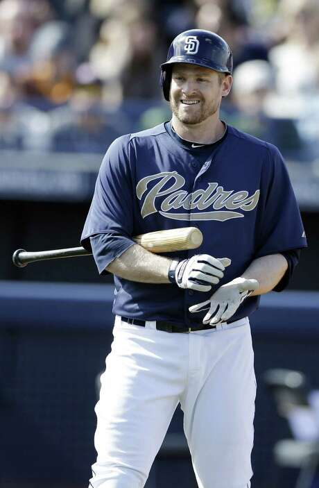 Chase Headley broke the tip of his left thumb Sunday and will miss at least the first two weeks. Photo: Gregory Bull / Associated Press