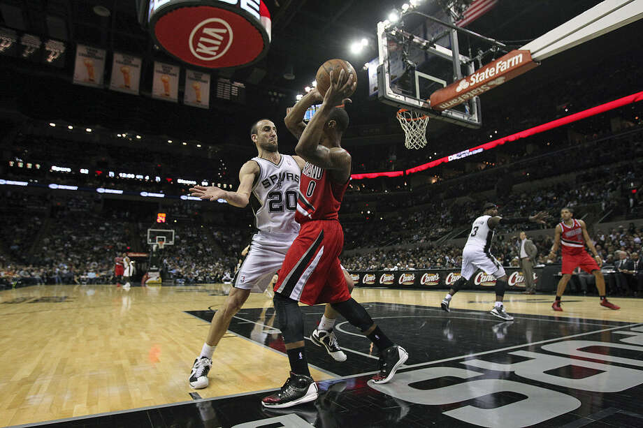 Manu Ginobili says the solution to the Spurs' recent defensive woes starts with individuals stepping up. Photo: Tom Reel / San Antonio Express-News
