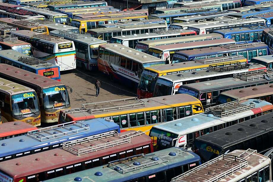 Buses are parked at an inter-district bus terminal during a nationwide strike in Dhaka on March 18, 2013.  The nationwide strike, called by the Bangladesh Nationalist Party (BNP)-led 18-Party Alliance to protest against the arrest of their leaders, began amidst tight security. MUNIR UZ ZAMAN/AFP/Getty Images Photo: Munir Uz Zaman, AFP/Getty Images