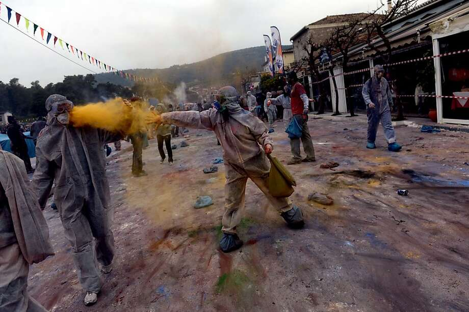 People throw flour at each other as they celebrate the annual custom of Flour War in Galaxidi, some 250kms south east of Athens on March 18, 2013. ARIS MESSINIS/AFP/Getty Images Photo: Aris Messinis, AFP/Getty Images