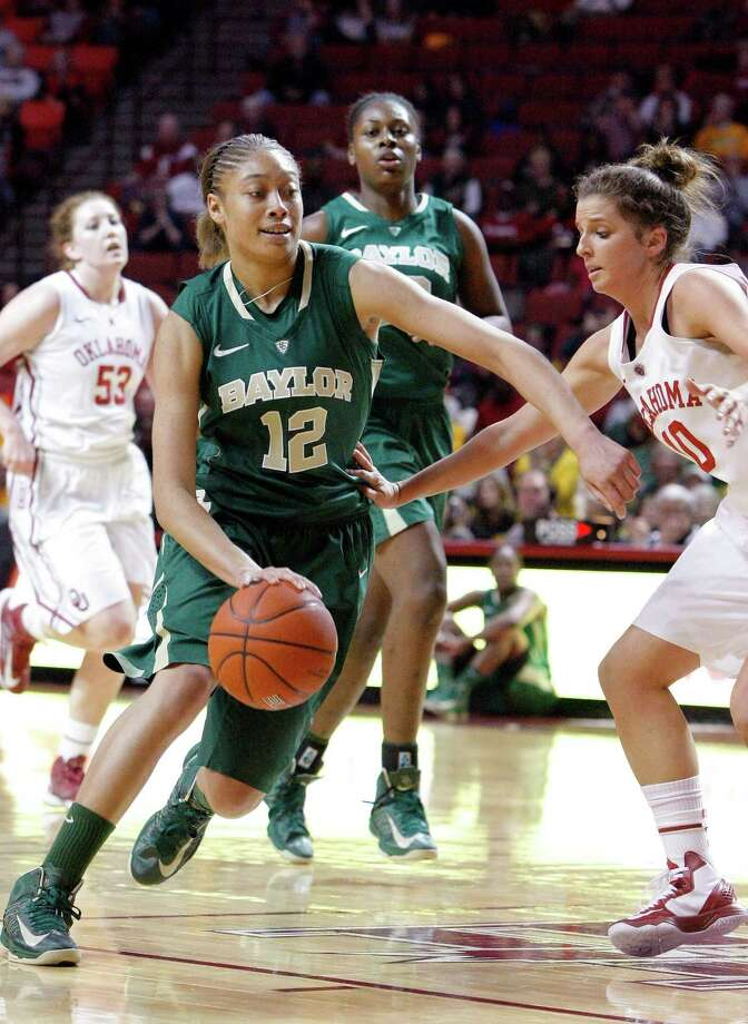 Baylor guard Alexis Prince (12) drives to the basket around Oklahoma guard Morgan Hook (10) during the first half of a NCAA Women's basketball game in Norman, Monday, Feb. 25, 2013.  (AP Photo/Alonzo Adams) Photo: Alonzo Adams, Associated Press / FR159426 AP