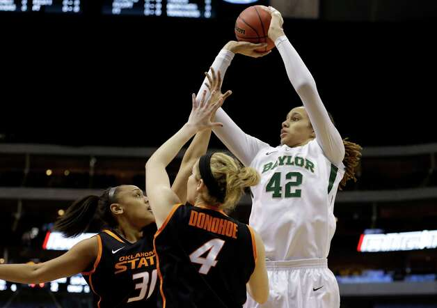 Oklahoma State's Kendra Suttles (31) and Liz Donohoe (4) defend against a shot attempt by Baylor center Brittney Griner (42) during an NCAA college basketball game in the Big 12 women's tournament Sunday, March 10, 2013, in Dallas. Baylor won 77-69. (AP Photo/Tony Gutierrez) Photo: Tony Gutierrez, Associated Press / AP