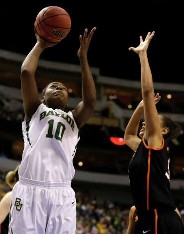 Baylor' Destiny Williams (10) goes up for a shot against Oklahoma State' Kendra Suttles, left, in the first half of an NCAA college basketball game in the Big 12 women's tournament Sunday, March 10, 2013, in Dallas. (AP Photo/Tony Gutierrez) Photo: Tony Gutierrez, Associated Press / AP