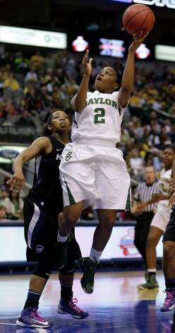 Baylor's Niya Jonson (2) shoots past Kansas State's Mariah White during the first half of an NCAA college basketball game in the Big 12 Conference tournament on Saturday, March 9, 2013, in Dallas. Baylor won 80-47. (AP Photo/LM Otero) Photo: LM Otero, Associated Press / AP