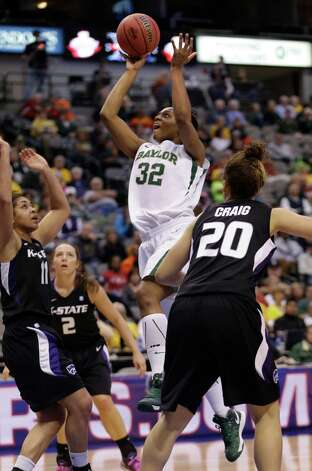 Baylor's Brooklyn Pope shoots past Kansas State's Chantay Caron (11), Bri Craig (20) and Brittney Chambers (2) during the second half of an NCAA college basketball game in the Big 12 Conference tournament Saturday March 9, 2013, in Dallas. Baylor won 80-47. (AP Photo/LM Otero) Photo: LM Otero, Associated Press / AP