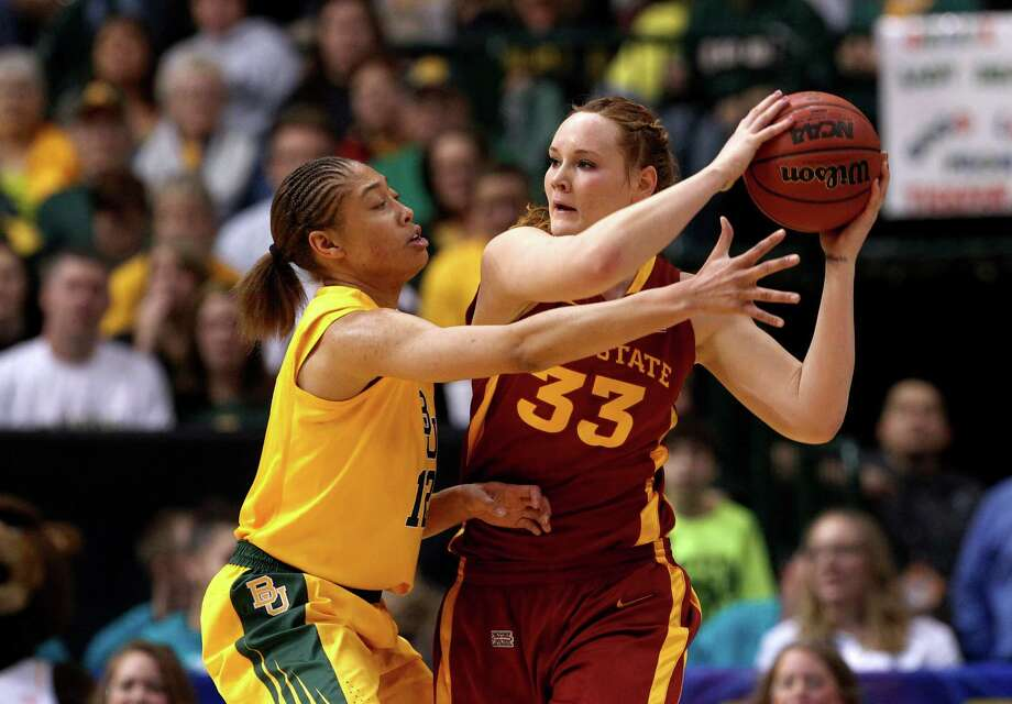 Baylor guard Alexis Prince (12) defends as Iowa State forward Chelsea Poppens (33) handles the ball during their NCAA college basketball championship game in the Big 12 Conference tournament, Monday, March 11, 2013, in Dallas. Baylor won 75-47. (AP Photo/Tony Gutierrez) Photo: Tony Gutierrez, Associated Press / AP