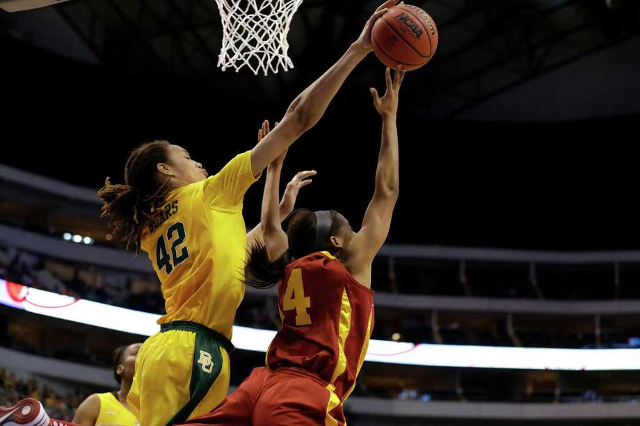 Baylor center Brittney Griner (42) blocks a shot attempt by Iowa State guard Nikki Moody (4) during their NCAA college basketball championship game in the Big 12 Conference tournament, Monday, March 11, 2013, in Dallas. Baylor won 75-47. (AP Photo/Tony Gutierrez) Photo: Tony Gutierrez, Associated Press / AP
