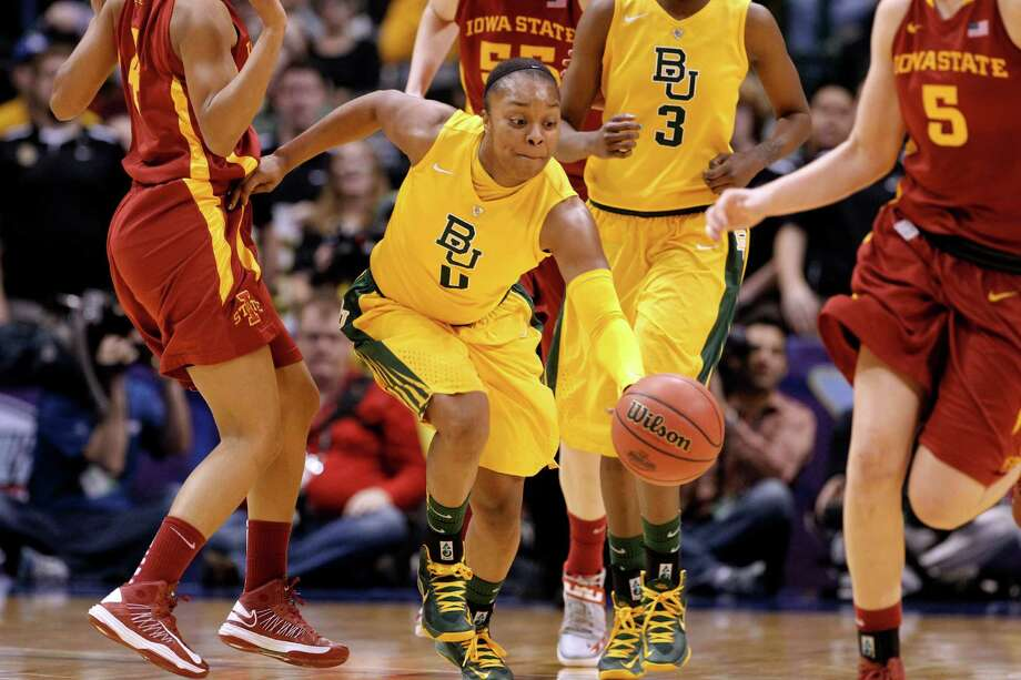 Baylor guard Odyssey Sims (0) chases down a loose ball against Iowa State forward Hallie Christofferson (5) during their NCAA college basketball championship game in the Big 12 Conference tournament, Monday, March 11, 2013, in Dallas. Baylor won 75-47. (AP Photo/Tony Gutierrez) Photo: Tony Gutierrez, Associated Press / AP