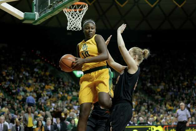 Baylor 's Destiny Williams (10) comes down with a rebound over Texas 's Gigi Mazionyte (23) during an NCAA college basketball game Saturday, Feb. 23, 2013, in Waco, Texas. (AP Photo/Tony Gutierrez) Photo: Tony Gutierrez, Associated Press / AP