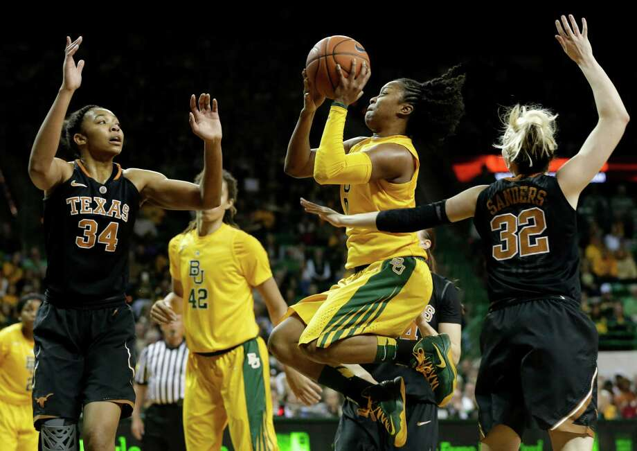 Texas' Imani McGee-Stafford (34) and Brady Sanders (32) defend as Baylor guard Odyssey Sims, center, goes up for a a score in the second half of an NCAA college basketball game Saturday, Feb. 23, 2013, in Waco, Texas. Sims had 15-points in the 67-47 Baylor win. (AP Photo/Tony Gutierrez) Photo: Tony Gutierrez, Associated Press / AP