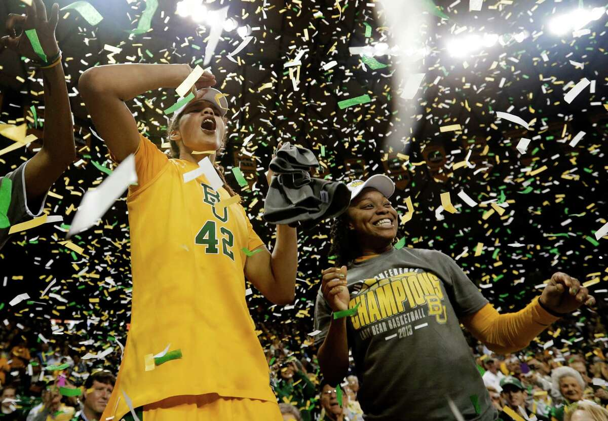 Baylor's Brittney Griner (42) and Odyssey Sims, right, celebrate their the Big 12 Conference title after they defeated Texas 67-47 in an NCAA college basketball game against Texas Saturday, Feb. 23, 2013, in Waco, Texas. (AP Photo/Tony Gutierrez)
