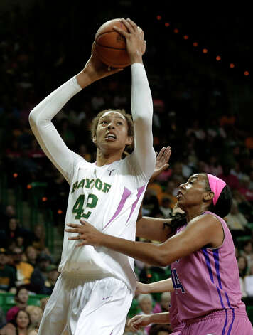 Baylor 's Brittney Griner (42) goes up for a score over TCU 's Ashley Colbert (44) in the second half of an NCAA college basketball game Saturday, Feb. 16, 2013, in Waco, Texas. Baylor won 78-45.  (AP Photo/Tony Gutierrez) Photo: Tony Gutierrez, Associated Press / AP