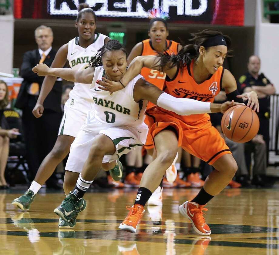 Baylor's Odyssey Sims (0) left, reaches for a loose ball with Oklahoma State's Tiffany Bias (3), right, in the second half of an NCAA college basketball game on Sunday, Jan. 6, 2013, in Waco, Texas. (AP Photo/Waco Tribune Herald, Rod Aydelotte) Photo: Rod Aydelotte, Associated Press / Waco Tribune Herald