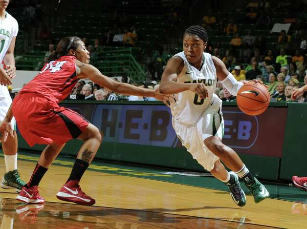 Baylor's Odyssey Sims, right, drives on Lamar's Carenn Baylor, left, in the first half of an NCAA college basketball game, Friday, Nov. 9, 2012, in Waco, Texas. Baylor won 80-34. (AP Photo/Waco Tribune Herald, Rod Aydelotte) Photo: Rod Aydelotte, Associated Press / Waco Tribune Herald