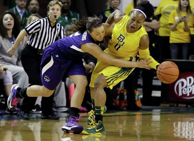 Baylor guard Odyssey Sims (0) steals the ball from Kansas State guard Brittany Chambers (2) during the second half of an NCAA college basketball game Monday, March 4, 2013, in Arlington, Texas. Baylor won 90-68. (AP Photo/LM Otero) Photo: LM Otero, Associated Press / AP