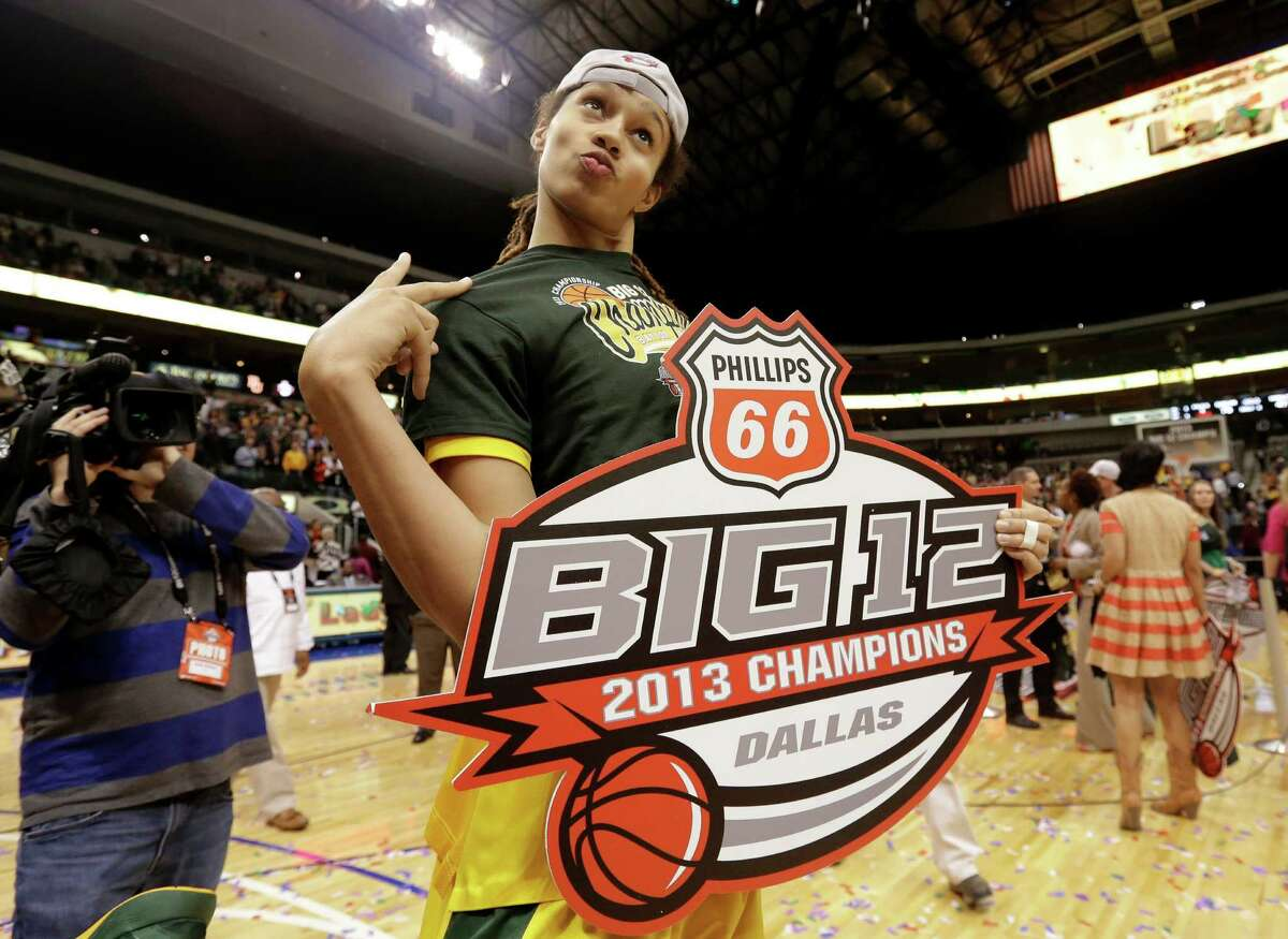 Baylor's Brittney Griner, jokes around as she poses for photographers with the 2013 Big 12 Championship sign after their NCAA college basketball championship game against Iowa State in the Big 12 Conference tournament, Monday, March 11, 2013, in Dallas. Baylor won 75-47. (AP Photo/Tony Gutierrez)
