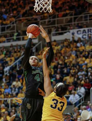 Baylor's Brittney Griner (42) shoots over West Virginia's Ayana Dunning (33) during the first half of an NCAA college basketball game in Morgantown, W.Va., on Saturday, March 2, 2013. (AP Photo/David Smith) Photo: David Smith, Associated Press / FR93543 AP