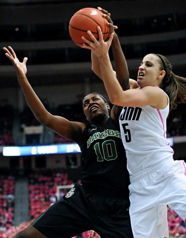 Baylor's Destiny Williams, left, and Connecticut's Caroline Doty, right, fight for control of the ball during the first half of an NCAA college basketball game in Hartford, Conn., Monday, Feb. 18, 2013. (AP Photo/Jessica Hill) Photo: Jessica Hill, Associated Press / FR125654 AP