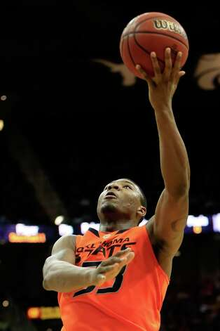 Who's hot: Oklahoma State G Marcus Smart — The league's best player has played like it in recent games, averaging 21 points, 6.3 rebounds, 3.3 assists and 3.0 steals in his last four games. Photo: Jamie Squire, Getty Images / 2013 Getty Images