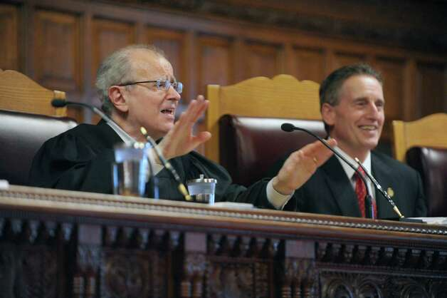Jonathan Lippman, left, Chief Judge of the Court of Appeals, addresses those gathered, including Lieutenant Governor Robert Duffy, right, during the swearing-in ceremony for Justice Jenny Rivera on the Court of Appeals on Monday, March 18, 2013 in Albany, NY.   (Paul Buckowski / Times Union) Photo: Paul Buckowski