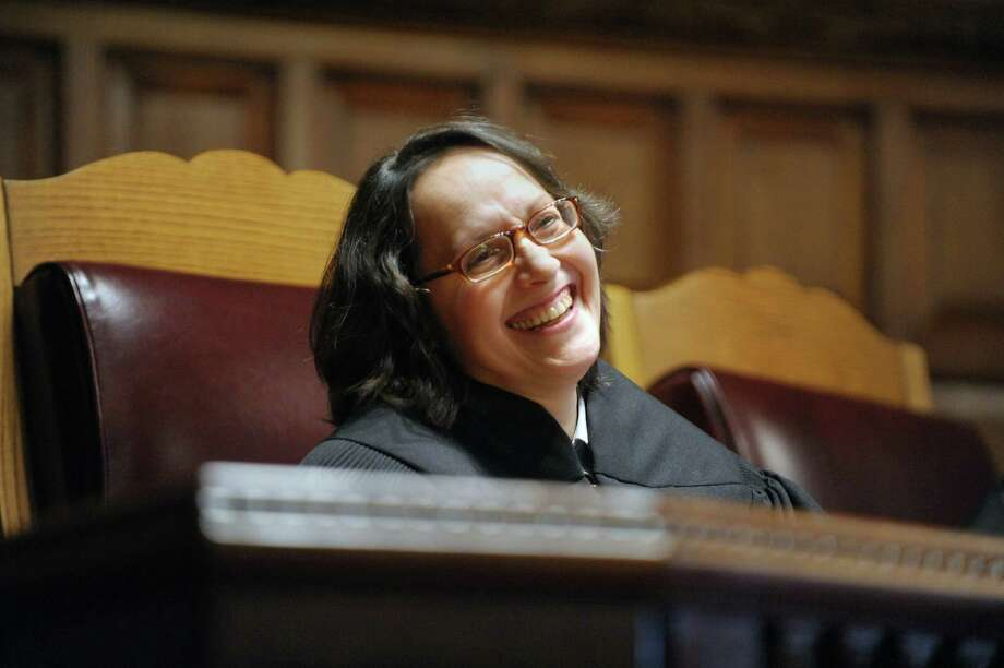 Court of Appeals Justice Jenny Rivera smiles at visitors in the crowd during her swearing-in ceremony  on Monday, March 18, 2013 in Albany, NY.   (Paul Buckowski / Times Union) Photo: Paul Buckowski