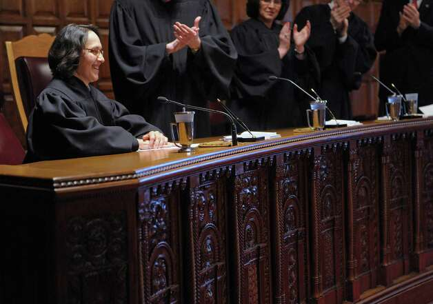 Court of Appeals Justice Jenny Rivera receives a standing ovation following her remarks after being sworn-in on Monday, March 18, 2013 in Albany, NY.   (Paul Buckowski / Times Union) Photo: Paul Buckowski