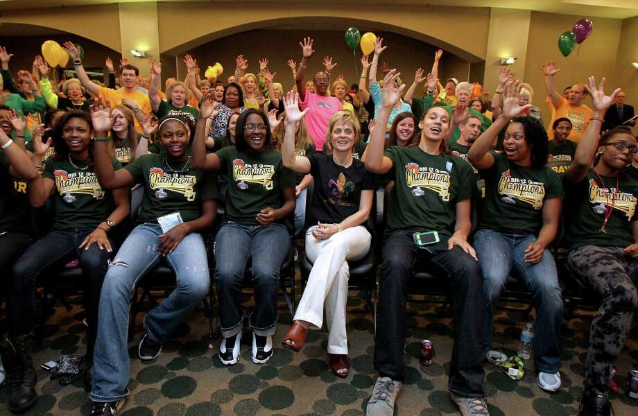 "Coach Kim Mulkey (center) and her team give the ""Sic 'em Bears"" sign as they watch the selections. Photo: Jerry Larson / Waco Tribune-Herald"