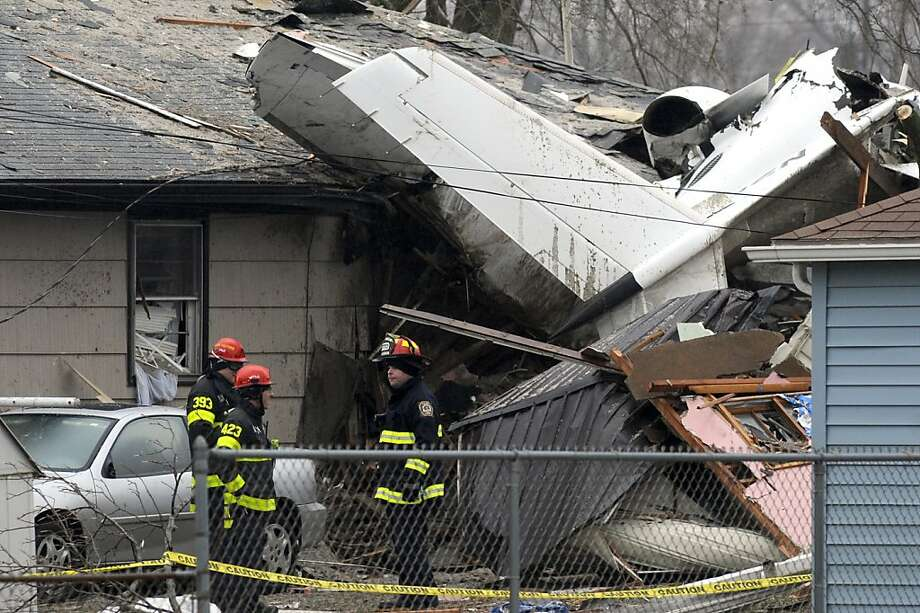 South Bend firefighters work at the scene, Monday, March 18, 2013, where a plane crashed on Sunday, near the South Bend Regional Airport, in South Bend, Ind. The plane damaged homes, as well as causing injuries. (AP Photo/Joe Raymond) Photo: Joe Raymond, Associated Press
