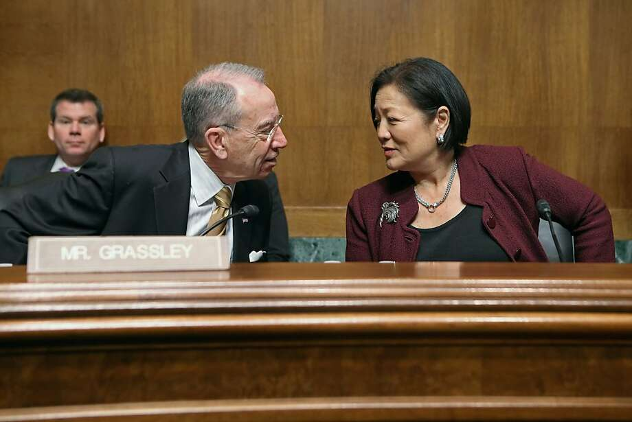 WASHINGTON, DC - MARCH 18:  Senate Judiciary Committee ranking member Sen. Charles Grassley (R-IA) (L) and Sen. Mazie Hirono (D-HI) visit before the start of a full committee hearing March 18, 2013 in Washington, DC. The committee heard testimony about immigration reform in regards to women and families during the hearing, titled 'How Comprehensive Immigration Reform Should Address the Needs of Women and Families.'  (Photo by Chip Somodevilla/Getty Images) Photo: Chip Somodevilla, Getty Images