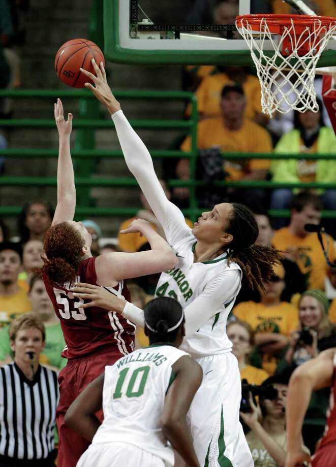 FILE - In this Jan. 26, 2013 file photo, Baylor's Brittney Griner (42) blocks the shot of Oklahoma's Joanna McFarland (53) during the second half of an NCAA college basketball game in Waco Texas.  It was Griners' 665th career blocked shot. Long before Griner was swatting away shots for top-ranked Baylor, there was another 6-foot-8 women's college player getting blocks at a record pace. Anne Donovan even had more blocked shots that Griner's NCAA-recognized record for men or women. (AP Photo/LM Otero, File) Photo: LM Otero / AP