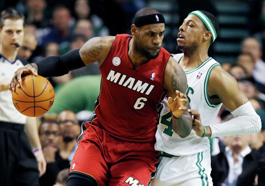 Miami Heat's LeBron James (6) backs down on Boston Celtics' Paul Pierce (34) in the first quarter of an NBA basketball game in Boston, Monday, March 18, 2013. (AP Photo/Michael Dwyer) Photo: Michael Dwyer