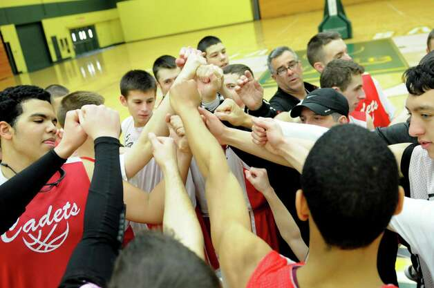 Albany Academy basketball basketball team members come together Monday March 18, 2013, following practice at Siena College in Loudonville, N.Y. The Cadets are preparing to compete in the Federation Basketball Tournament this Friday. (Will Waldron/Times Union) Photo: Will Waldron