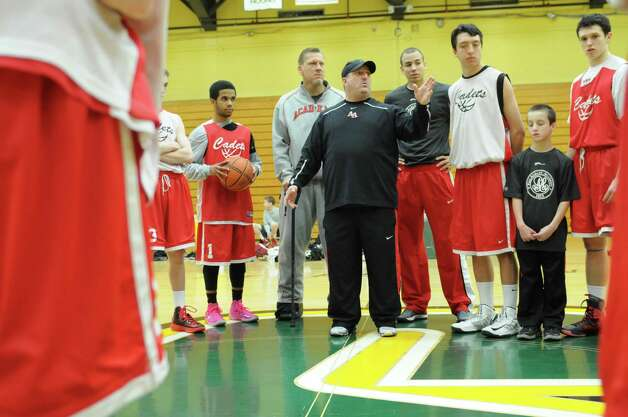 Albany Academy basketball coach Brian Fruscio motivates his players Monday, March 18, 2013, during a practice session at Siena College in Loudonville, N.Y. The Cadets are preparing to compete in the Federation Basketball Tournament this Friday. (Will Waldron/Times Union) Photo: Will Waldron