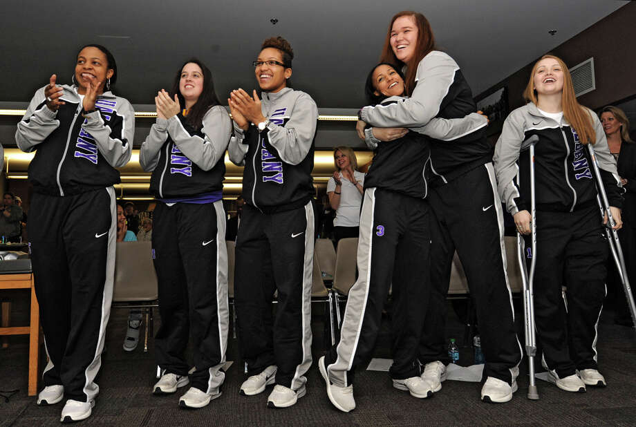 From left, UAlbany basketball players Ebone Henry, Lindsey Lowrie, Keyontae Williams, Margarita Rosario, Megan Craig and Erin Coughlin react after being matched with North Carolina in Delaware in the NCAA Tournament as the team holds a selection show party at SEFCU Arena on Monday, March 18, 2013 in Albany, N.Y.  (Lori Van Buren / Times Union) Photo: Lori Van Buren