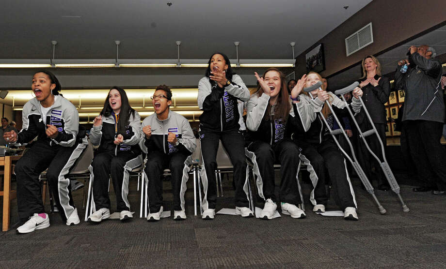 From left, UAlbany basketball players Ebone Henry, Lindsey Lowrie, Keyontae Williams, Margarita Rosario, Megan Craig and Erin Coughlin react after being matched with North Carolina in Delaware in the NCAA Tournament as the team holds a selection show party at SEFCU Arena on Monday, March 18, 2013 in Albany, N.Y. Head coach Katie Abrahamson-Henderson reacts to the right of the them.  (Lori Van Buren / Times Union) Photo: Lori Van Buren