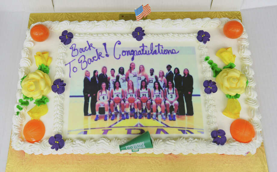 A cake awaits cutting as the UAlbany women's basketball team holds a selection show party at SEFCU Arena on Monday, March 18, 2013 in Albany, N.Y. The team was matched to play North Carolina in Delaware. (Lori Van Buren / Times Union) Photo: Lori Van Buren