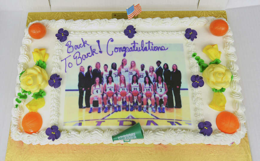 A cake awaits cutting as the UAlbany women's basketball team holds a selection show party at SEFCU A