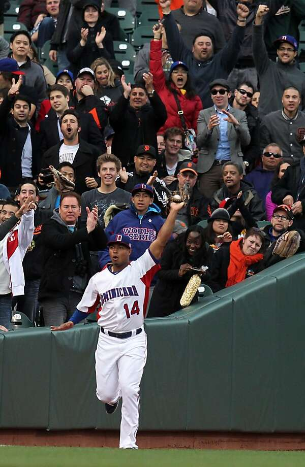 Dominican Republic left fielder Moises Sierra holds up a foul ball hit by the Netherlands' Andruw Jones in the first inning. Photo: Lance Iversen, The Chronicle