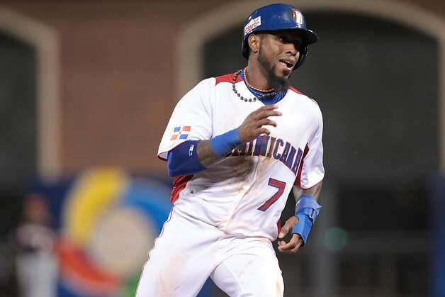 Dominican Republic's Jose Reyes runs to third base on a single by Miguel Tejada in the fifth inning against the Netherlands while playing in a World Baseball Classic semi-final game in San Francisco on Monday, March 18, 2013. Photo: Mathew Sumner, Special To The Chronicle